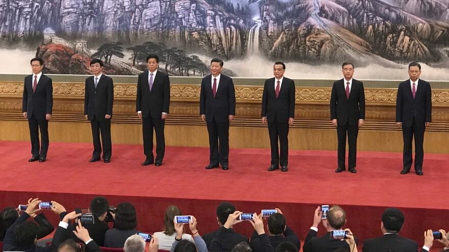 New members of the Politburo Standing Committee (from left) Han Zheng, Wang Huning, Li Zhanshu, Xi Jinping, Li Keqiang, Wang Yang and Zhao Leji stand together at Beijing's Great Hall of the People on Wednesday.