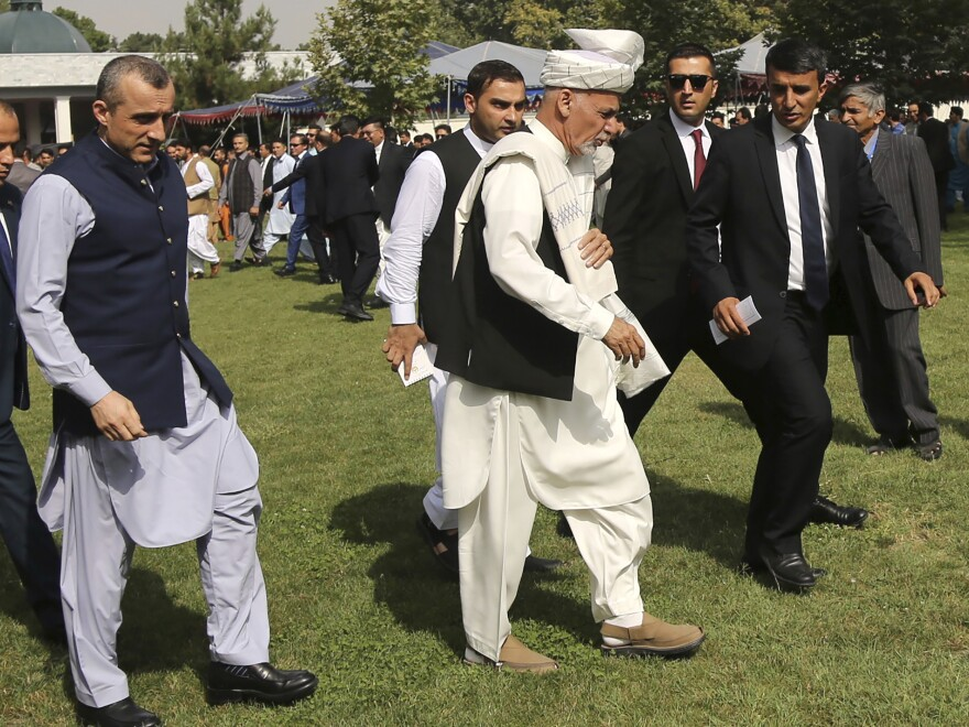 Afghanistan's President Ashraf Ghani (center) arrived for a speech after offering Eid al-Adha prayers at the presidential palace in Kabul.