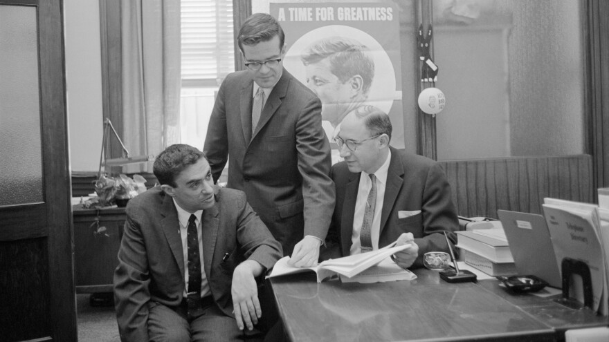 Richard Goodwin (left) worked for John F. Kennedy, first on his presidential campaign and then in the White House. He also wrote influential speeches for President Lyndon Johnson. Goodwin is seen here with Ted Sorensen (center) and Myer Feldman.
