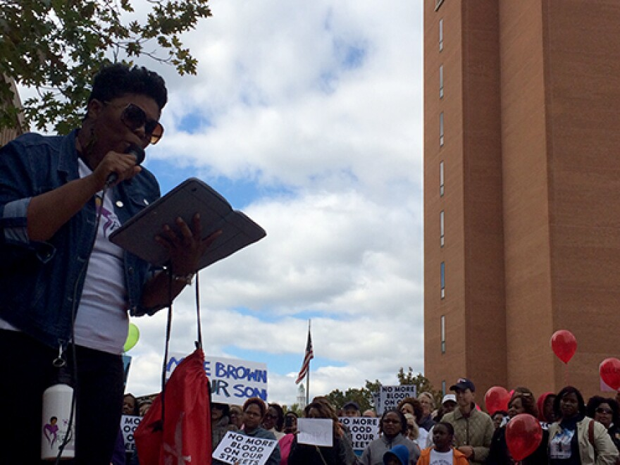Rev. Traci Blackmon of Christ the King UCC reads a list of names of victims of violence on Saturday, October 18, 2014.