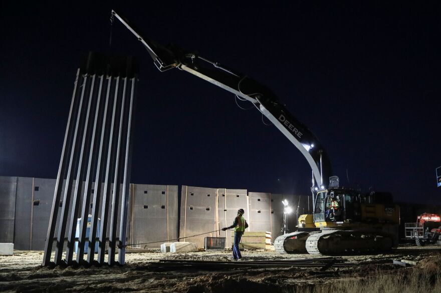 U.S. Workers build the new 13-mile border wall construction project in the desert between Sunlad Park, N.M., and Ciudad Juarez, Chihuahua, Mexico on Jan. 15.