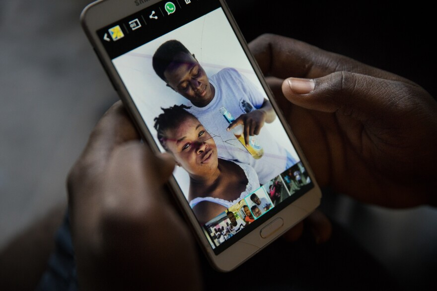 Bobson Timothee keeps a photo on his phone of himself with his best friend, Stephanie Forestal, who died during the storm.