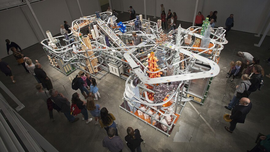 About 1,200 tiny custom-made cars zoom around <em>Metropolis II</em>. If there's an accident, the sculpture comes with nearly 11,000 more toy cars, ready to hit the road.