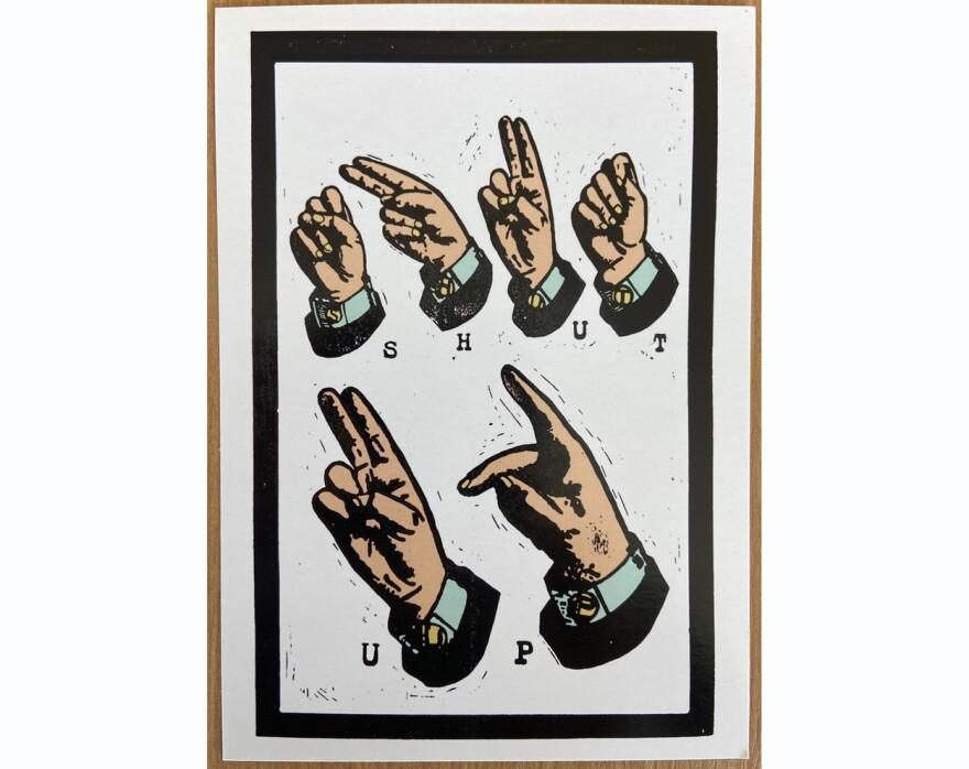A postcard spells SHUT UP in sign language.