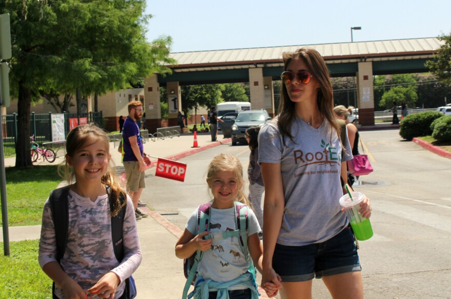 Cameron Vickrey picks up her daughters Finley, 9, and Zetta, 7, from their North East ISD neighborhood school, Oak Meadow Elementary on May 21, 2019.