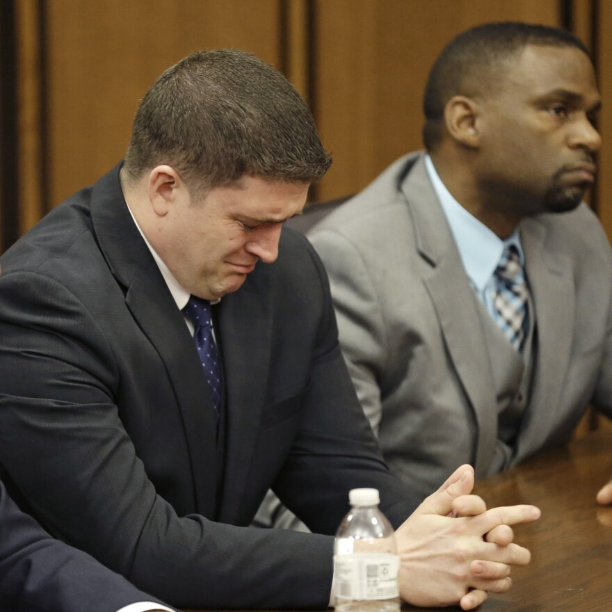 Michael Brelo weeps as he hears the verdict in his trial Saturday, in Cleveland. Brelo, a patrolman charged in the shooting deaths of two unarmed suspects during a 137-shot barrage of gunfire was acquitted.
