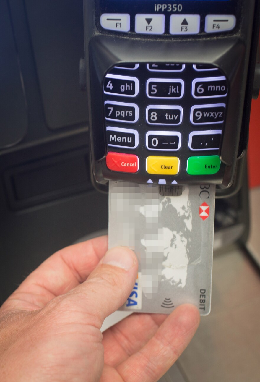 New embedded computer chips mean that the day is coming when you'll never swipe your credit card again. Instead, you'll insert them into readers like this.