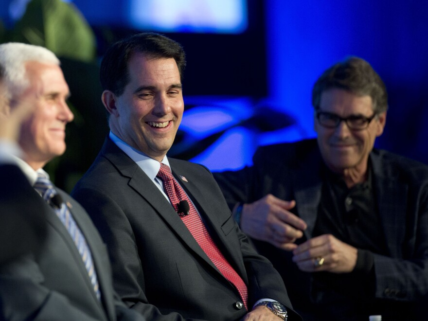 Wisconsin Gov. Scott Walker (center) talks about recent Republican Party gains and the road ahead for the party as Indiana Gov. Mike Pence (left) and Texas Gov. Rick Perry listen during a news conference at the Republican Governors Association conference in Boca Raton, Fla.