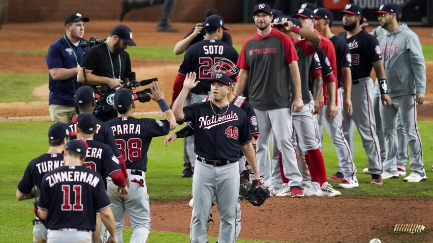 The Washington Nationals celebrate after Game 2 of the World Series against the Houston Astros Thursday in Houston. The Nationals won 12-3 to take a 2-0 lead in the Series.