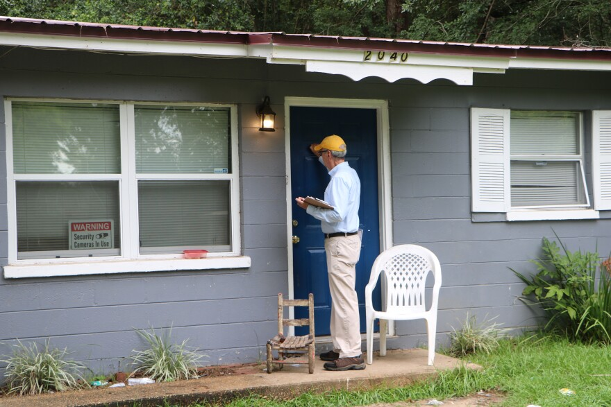 Bob Rackleff knocking on a door hoping to register voters.