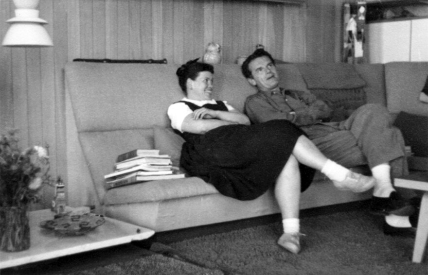 Ray and Charles relax on a built-in sofa in their living room alcove in 1951.