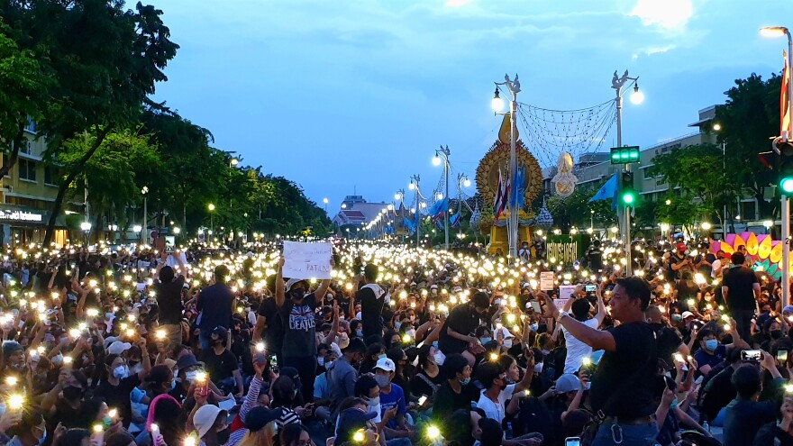 Lighted cellphones held up by demonstrators calling for an end to the military backed government, in Bangkok, Sunday.