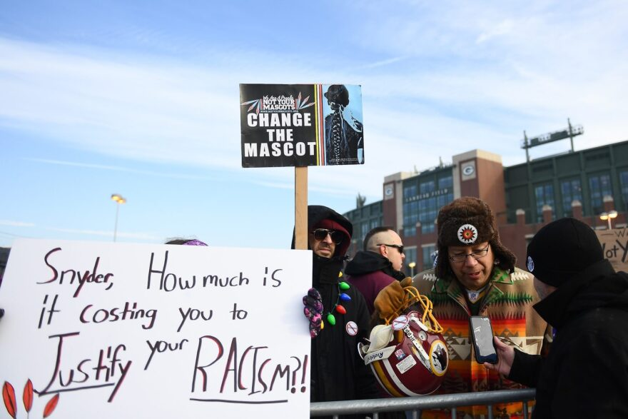 Protestors rally in Green Bay, Wisconsin prior to a December 2019 game between the Packers and Washington, D.C.'s football team.