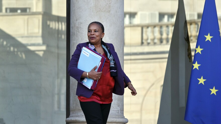 France's Justice Minister Christiane Taubira, who resigned on Wednesday, is shown here leave the Elysee Palace after the weekly cabinet meeting in Paris in December.