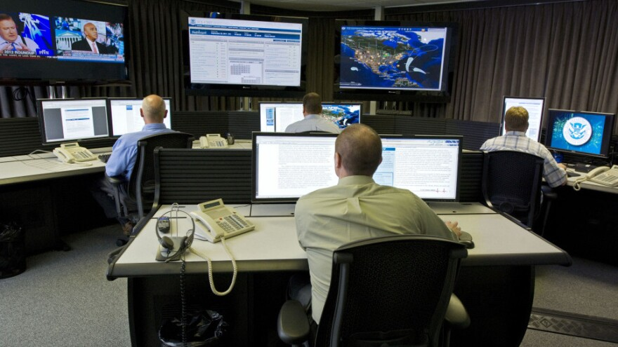 Cybersecurity analysts work in the watch and warning center during the first tour of the government's secretive cyberdefense lab intended to protect the nation's power, water and chemical plants, electrical grid and other facilities on Sept. 29, 2011, in Idaho Falls, Idaho.