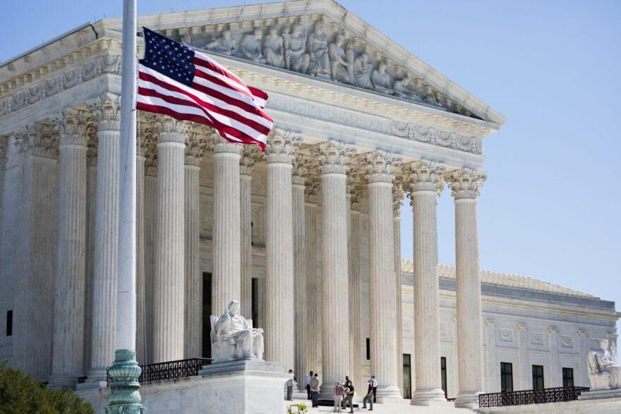 The flag flew at half-staff as hundreds of mourners visited the Supreme Court in Washington, D.C., after Justice Ruth Bader Ginsburg's death.
