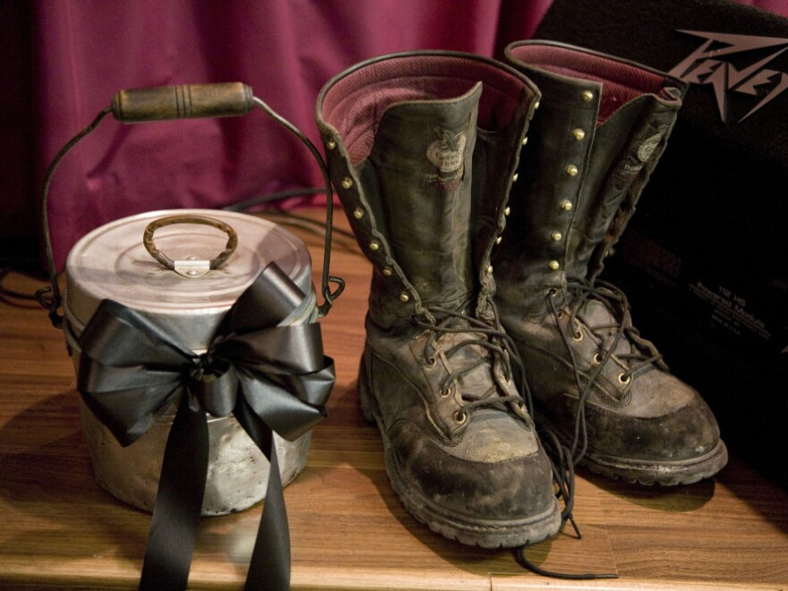 Coal miner boots and a lunch pail sat on the stage of the New Life Assembly church in Whitesville, W.Va., last April 11 during a Sunday service dedicated to the memory of the miners who were killed.