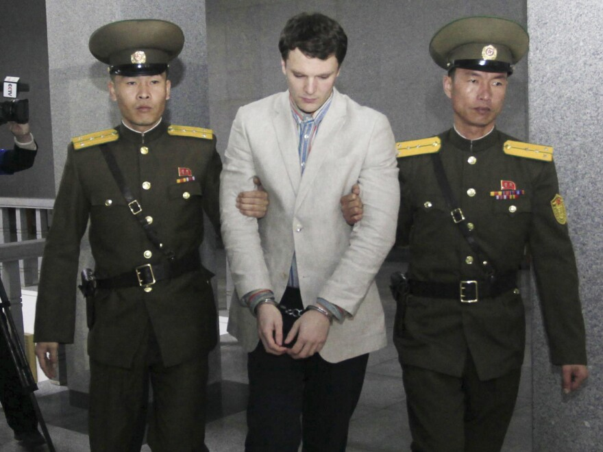 American student Otto Warmbier is escorted at the Supreme Court in Pyongyang, North Korea, on Wednesday. He was sentenced to 15 years of hard labor for subversion after he allegedly stole a propaganda poster.