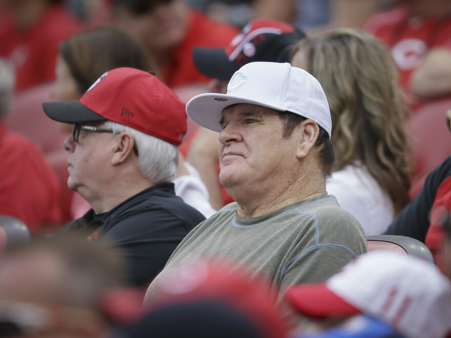 Former Cincinnati Reds' player and manager Pete Rose watches a baseball game between the Reds and Washington Nationals on May 31 in Cincinnati.