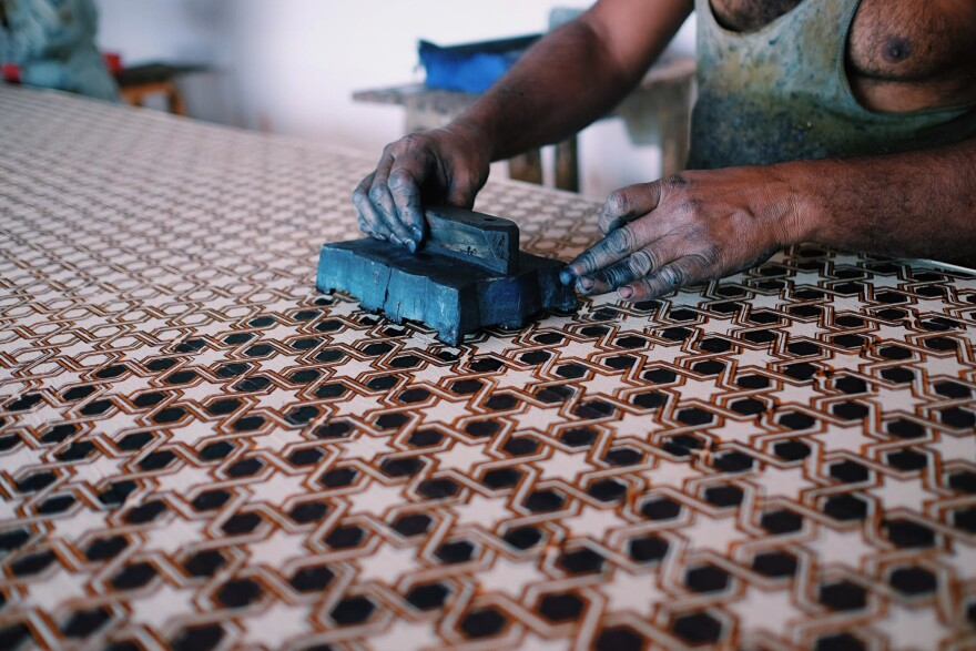 The nail beds of the artisans of Ajrakhpur are stained deep blue with natural indigo.
