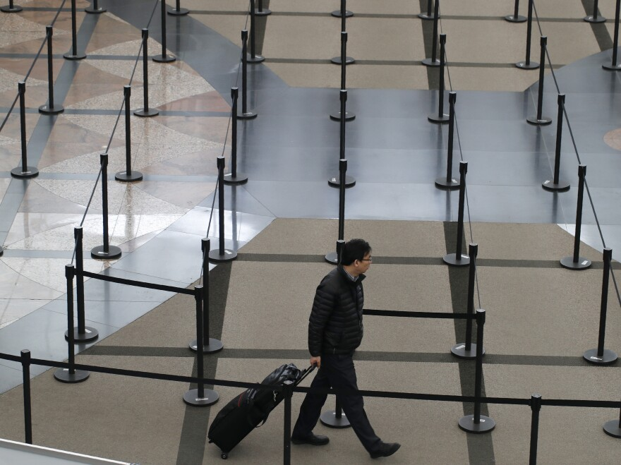 A traveler finds no line to stand in at a security checkpoint at Denver International Airport on Friday.