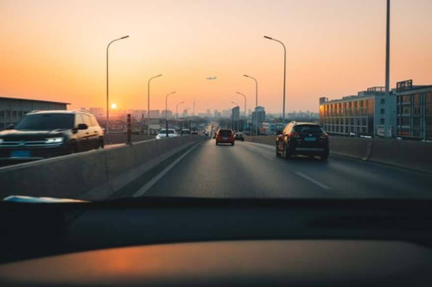 Cars on a road during Sunset