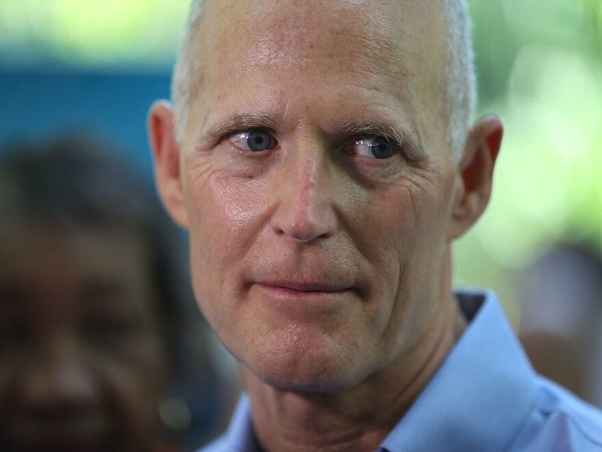 Florida Gov. Rick Scott at a news conference in May in Miami. A decision by a federal judge to strike down the state's procedure for restoring voting rights to felons who have served their time is seen as a defeat for the governor.