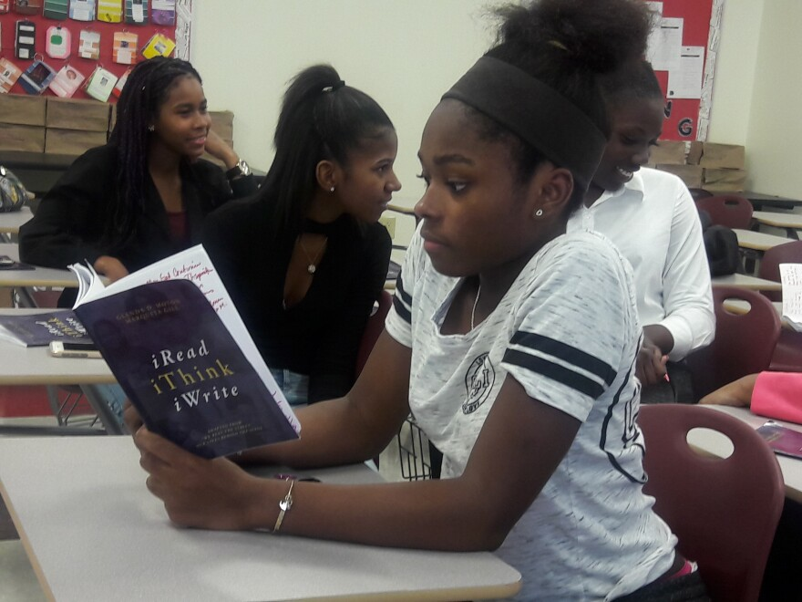 """A student in the Freshman Experience class at Miami Norland reads from the book the class published called, """"iRead iThink iWrite."""""""