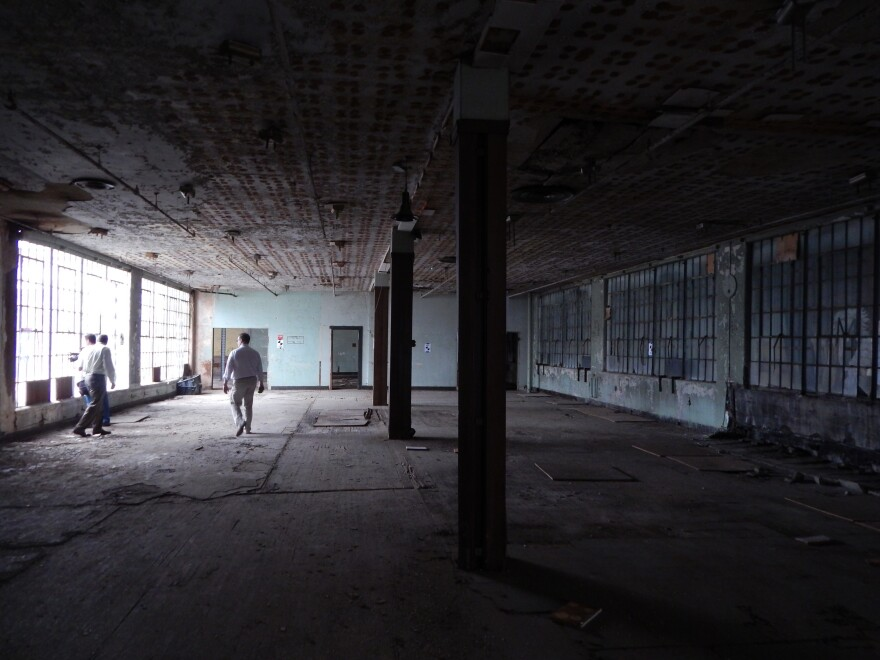 The old Delco building in downtown Dayton, largely offline since the 1980s, is being converted into apartments. Developers look out on the future courtyard.