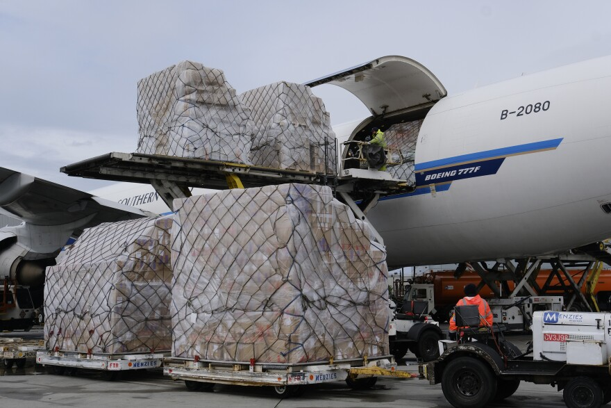 Ground crew at the Los Angeles International airport unload pallets of supplies of medical personal protective equipment from a China Southern Cargo plane upon its arrival on April 10, 2020.