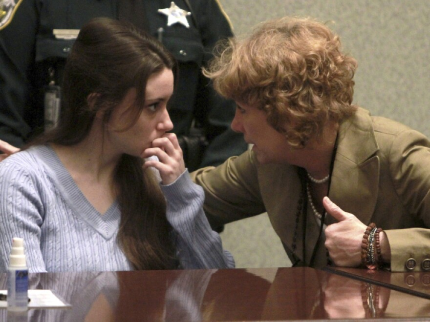 Casey Anthony talks with her attorney, Dorothy Clay Sims, before a sentencing hearing in Orlando, Fla. on Thursday, July 7, 2011. Anthony was acquitted of killing her daughter, Caylee, but faces four charges of lying to police officials.