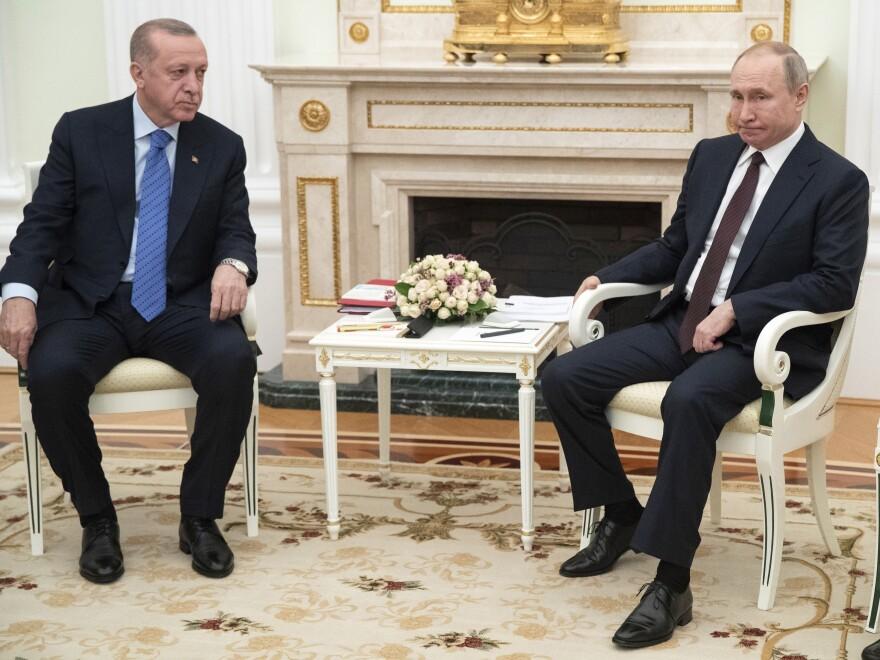 Russian President Vladimir Putin and Turkish President Recep Tayyip Erdogan talk during their meeting in the Kremlin, in Moscow on Thursday.