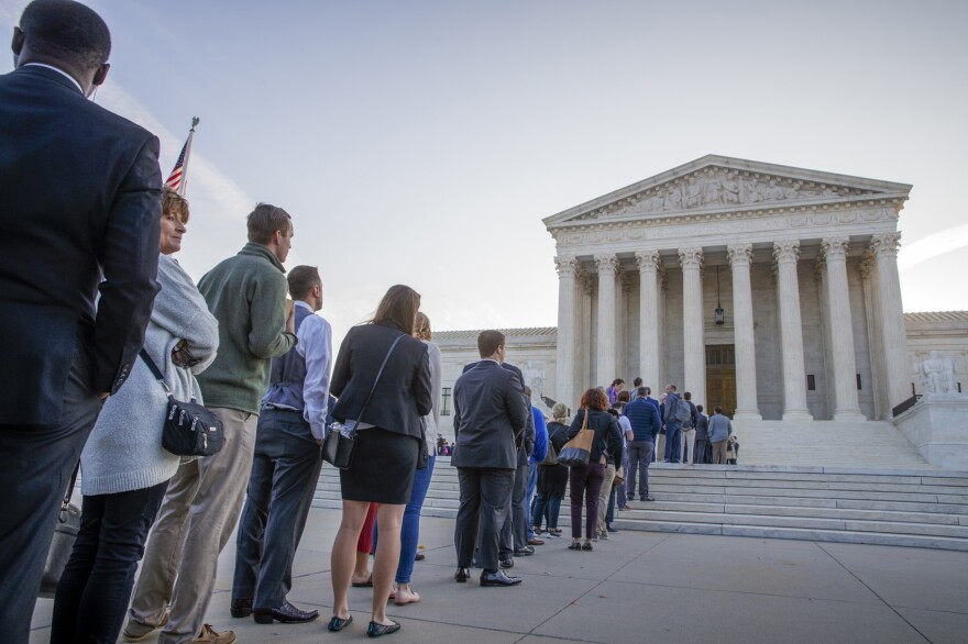 People line up at the Supreme Court on the first day of the new term, on Capitol Hill in Washington, Monday, Oct. 1, 2018. Amid the political chaos of Judge Brett Kavanaugh's nomination, the high court's work begins with only eight justices on the bench, four conservatives and four liberals. (AP Photo/J. Scott Applewhite)