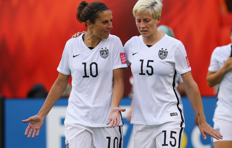 Carli Lloyd (left) and Megan Rapinoe are two of the five star players who filed a wage complaint against U.S. Soccer. The players say that the whole team supports their case, which accuses the national federation of paying male players far more money.