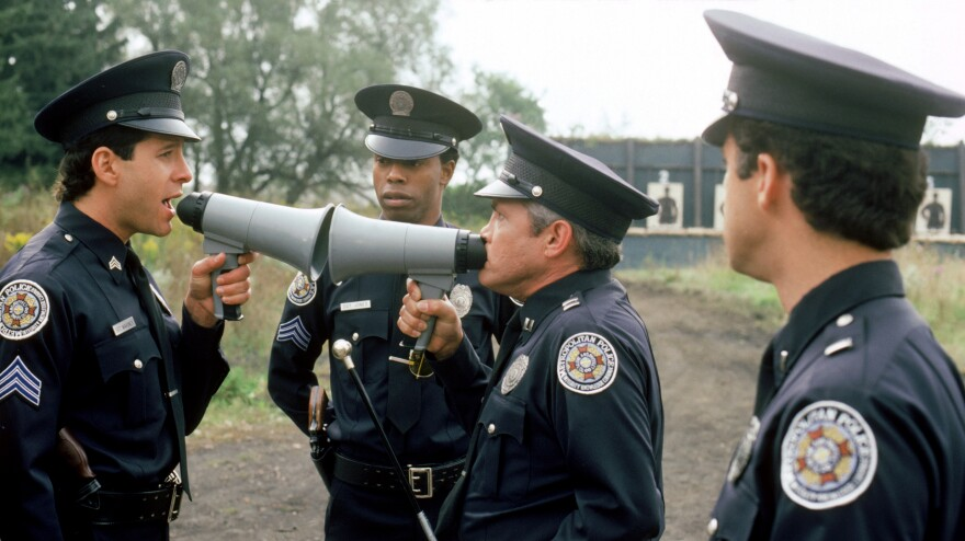 Steve Guttenberg (left), Michael Winslow (center) and G.W. Bailey star in 1987's <em>Police Academy 4: Citizens On Patrol</em>, part of the film franchise launched by 1984's <em>Police Academy</em>.