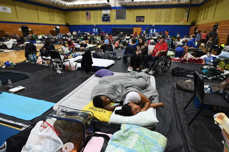 Local residents take shelter at Pedro Menendez High School in St. Augustine, Fla., on Thursday. Some 1.5 million people are under evacuation orders in Florida in preparation for Hurricane Matthew.