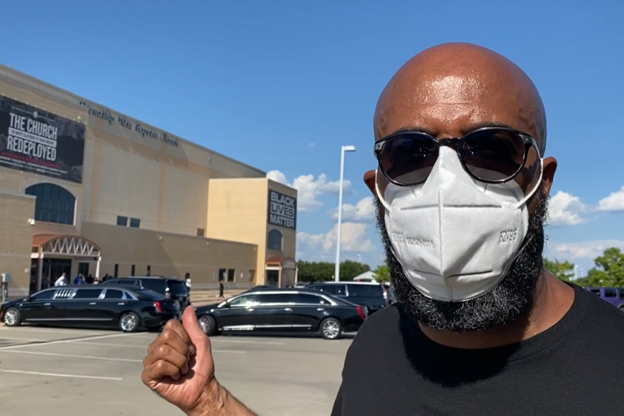 """Senior Pastor Frederick D. Haynes speaks during a video outside Friendship-West Baptist Church, where a group of undertakers was having a Black Lives Matter rally hours after the """"Back the Blue"""" cruisers left."""