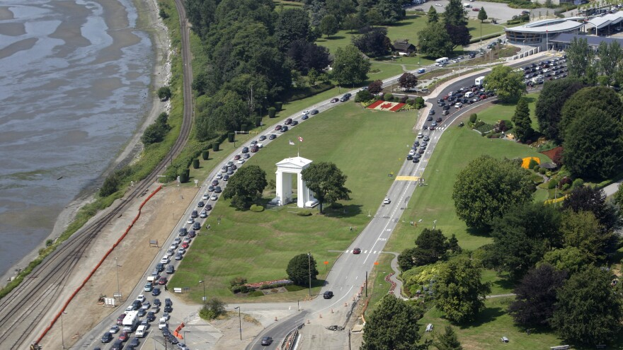 Cars line up to head into the United States (left) and into Canada (right) adjacent to Boundary Bay at a border crossing at Blaine, Wash., in 2009. A British couple who say they accidentally crossed the U.S.-Canada border were arrested by U.S. Customs and Border Protection agents on Oct. 3.