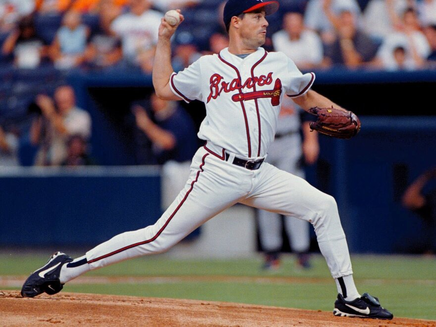 Atlanta Braves starting pitcher Greg Maddux delivers to a Baltimore Orioles batter at Turner Field in Atlanta in 1999.