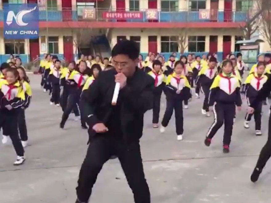 Video of a school in Shanxi province, China, shows principal Zhang Pengfei leading the students in a major update of the standard calisthenics routine.