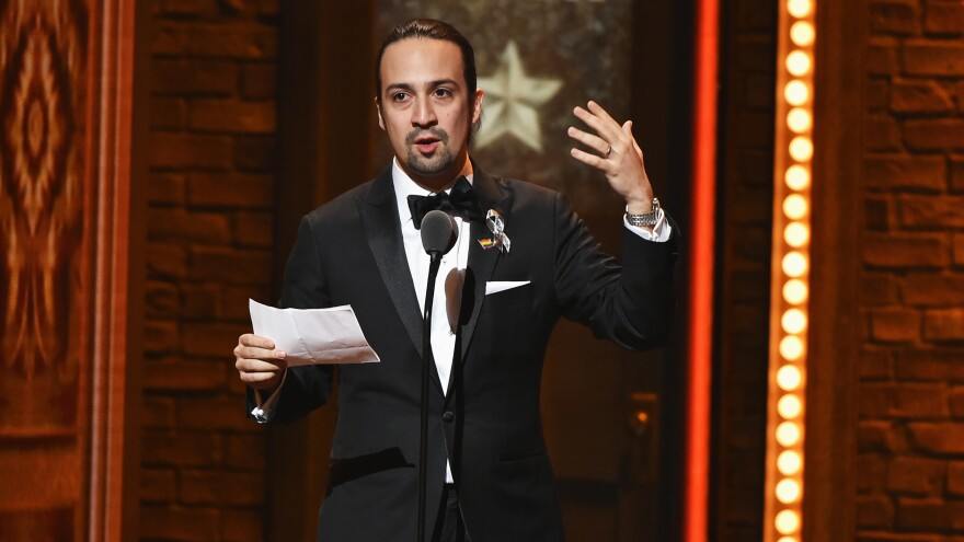 Lin-Manuel Miranda accepts the award for best book of a musical for <em>Hamilton</em> at the 70th Annual Tony Awards at the Beacon Theatre on Sunday.