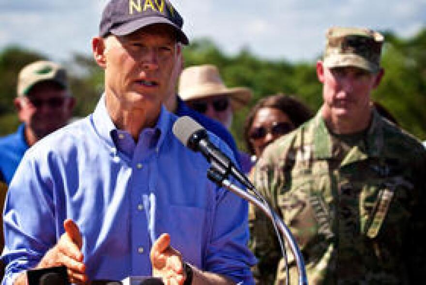 Florida Gov. Rick Scott and U.S. Army Corps of Engineers Col. Jason Kirk address concerns about safety of the Herbert Hoover Dike in Clewison on Oct. 9, 2017.