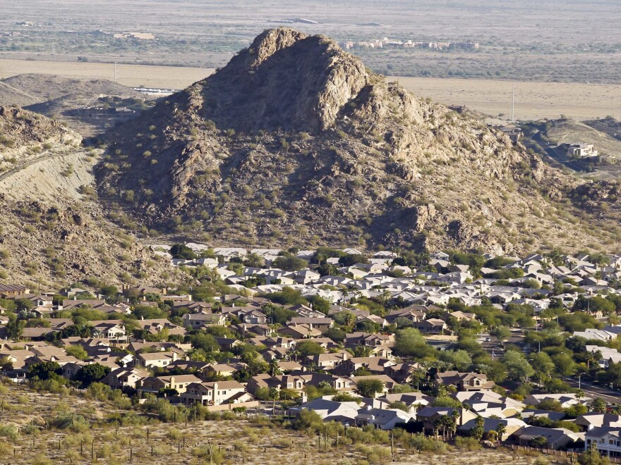 A housing development sits nestled in the South Mountain foothills in the Ahwatukee neighborhood in Phoenix. The city saw the biggest jump in population in the U.S. between 2017 and 2018.