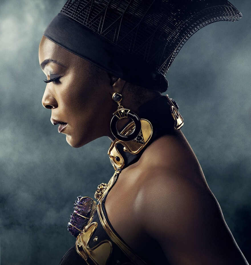"""<em>Black Panther</em> costume designer Ruth Carter """"really wanted something that was very, very strong,"""" Fletcher says of the necklace she designed for Angela Bassett's character, Ramonda."""