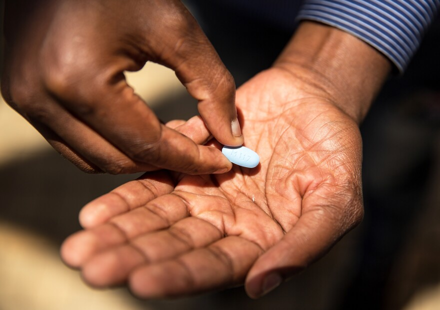 Thembelani Sibanda, of Soweto, South Africa, shows an HIV-preventing drug he takes to reduce the risk of becoming infected with HIV, an approach called pre-exposure prophylaxis, or PrEP.