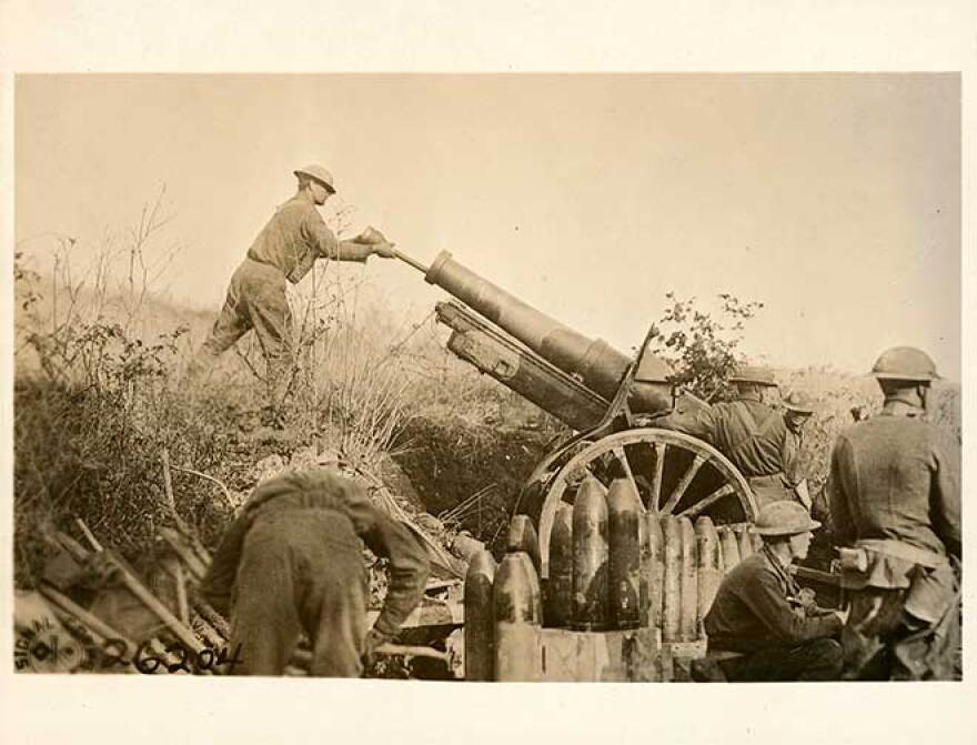 Photo of U.S. Signal Corps. 155 mm artillery cooperating with the 29th Division in position on a road just taken from the Germans.