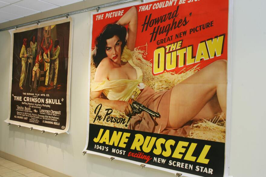 An original poster from the 1943 movie <em>The Outlaw</em> staring Jane Russell is shown on display at a Los Angeles auction house in December 2006.