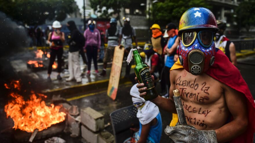 Opposition activists hold a fiery demonstration against the constituent assembly in Caracas on Friday, the day the legislative superbody was inaugurated. Onlookers fear the prospect of escalating violence as opposition activists' alternatives continue to diminish.