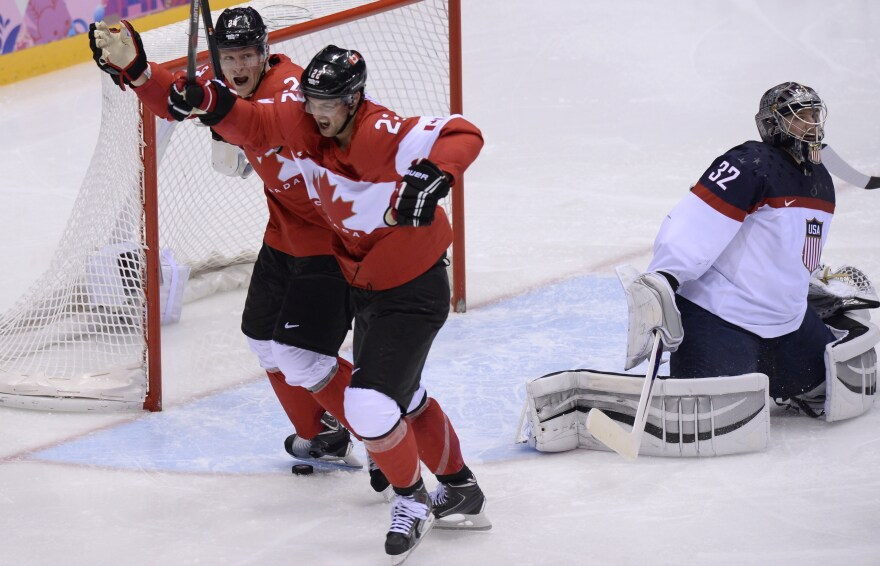 Canada's Jamie Benn (right) and Corey Perry celebrate a goal against America and goalie Jonathan Quick during the men's hockey semifinals in Sochi Friday.