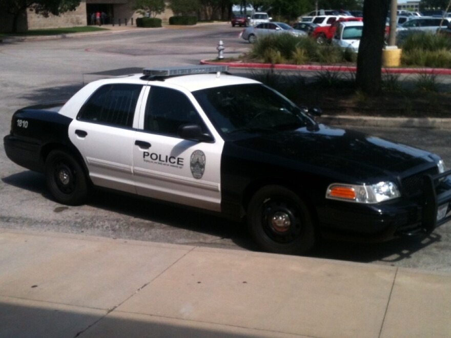Police_cruiser_by_Wells_Dunbar,_KUT_News.JPG